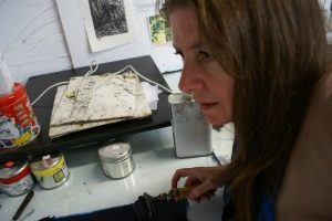 Rose Davies inking up a plate