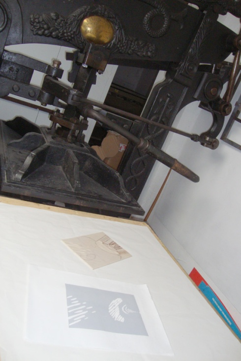 Printing the first colour on the antique Columbian Press at Swansea Print Workshop
